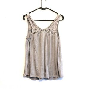 Laced up tie tank. Can wear forwards or backwards